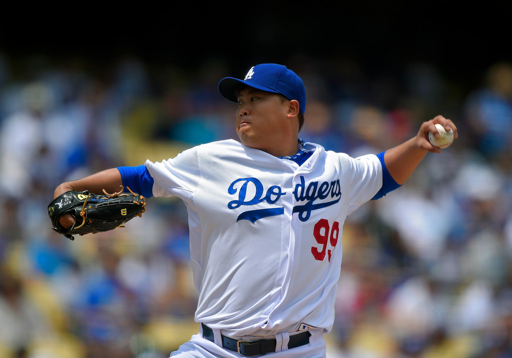. Los Angeles Dodgers starting pitcher Ryu Hyun-Jin, of South Korea, throws to the plate during the first inning of a baseball game against the Colorado Rockies, Sunday, April 27, 2014, in Los Angeles. (AP Photo/Mark J. Terrill)