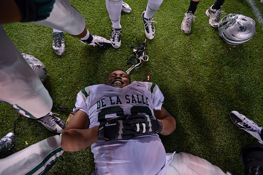 . De La Salle Spartans\' Xavier Banks (68) collapses to the ground after doing cart wheels after their win against the Centennial Huskies in the Open Division during the 2012 CIF State Football Championship at Home Depot Center in Carson , Calif. on Saturday, Dec. 15, 2012. De La Salle defeated Centennial 48-28. (Jose Carlos Fajardo/Staff)
