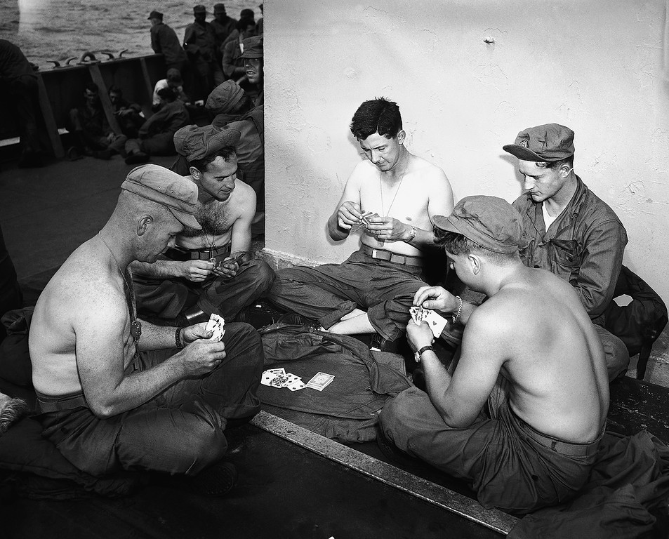 . Card game on the forward hatch on Sept. 15, 1951. From Left to right, around circle are Sgt. Gerald C. Jurs, Hamlin, New York; Cpl. Joseph M. Ferro, Bartlesville, Okla; Cpl. Cedric Smith, Brookhaven, Miss; Sgt. James N. Howell, Pecos, Texas and Cpl. Gordon W. Mehlenbacher of Hunt, New York, Sept. 15, 1951.