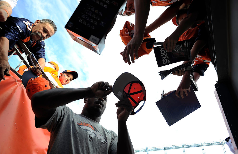 . Broncos Von Miller signs autographs for fans prior to the game.  The Denver Broncos vs The Tampa Bay Buccaneers at Sports Authority Field Sunday December 2, 2012. John Leyba, The Denver Post