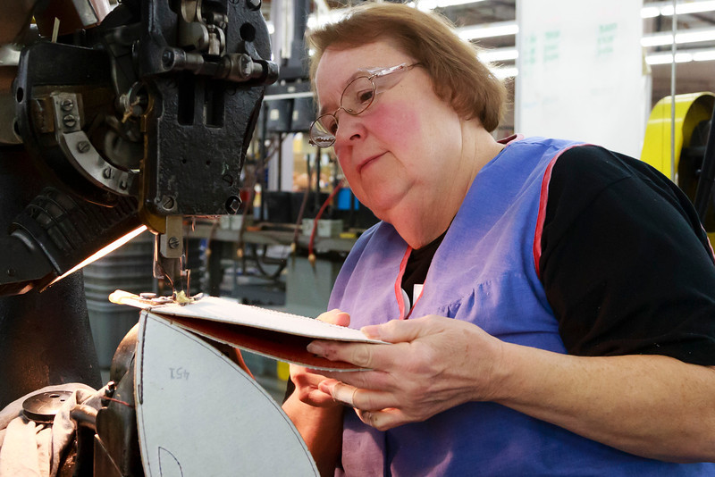 . Jane Helser sews an official game ball for the NFL football Super Bowl XLVII at Wilson Sporting Goods Co. in Ada, Ohio, Monday, Jan. 21, 2013.  (AP Photo/Rick Osentoski)