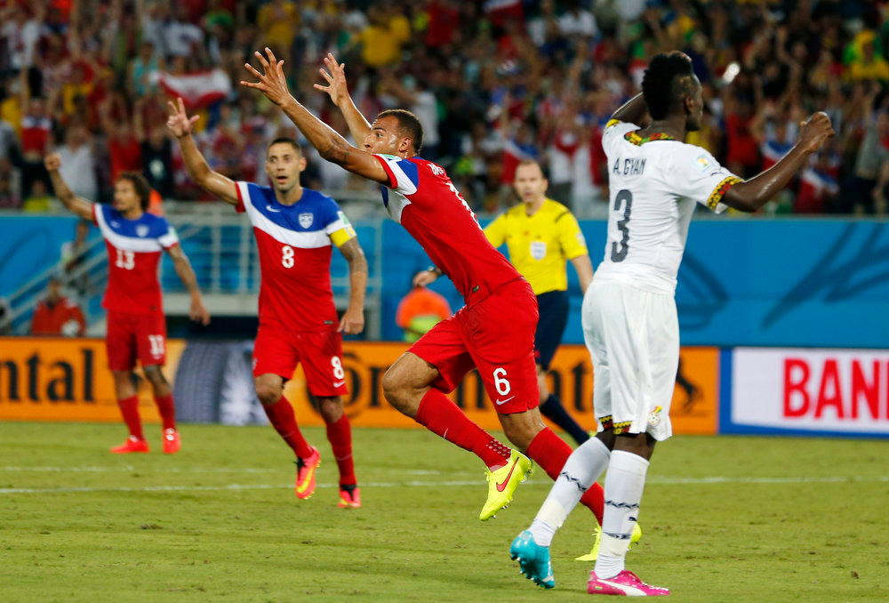 Description of . United States' John Brooks (6) celebrates with teammates after scoring his side's second goal during the group G World Cup soccer match between Ghana and the United States at the Arena das Dunas in Natal, Brazil, Monday, June 16, 2014. (AP Photo/Julio Cortez)