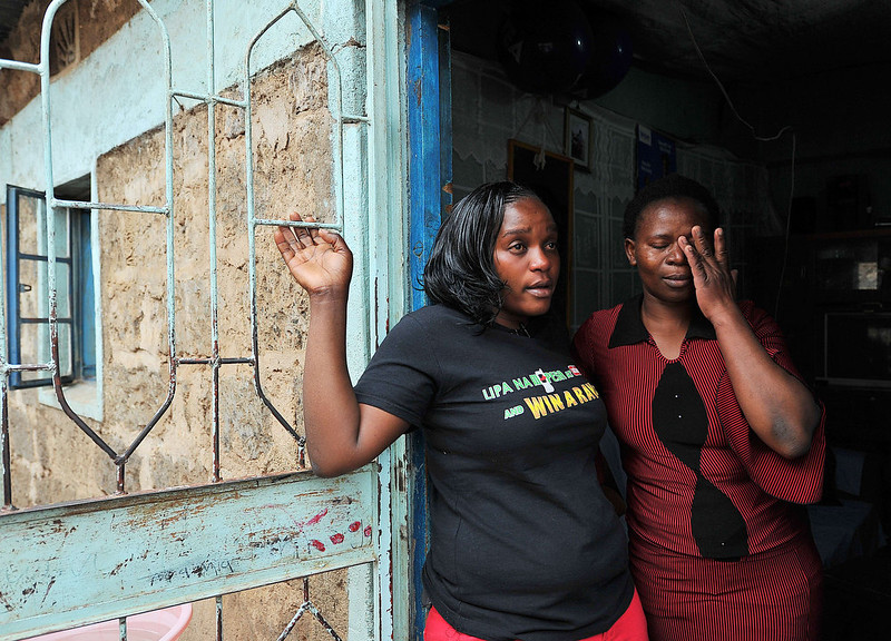 """. Eunice Khavetsa (L), 27, widow of Kenyan security guard Maurice Adembesa with her neighbour, Miriam Okola, 29, weep at Eunice\'s home in one of Nairobi\'s crowded suburbs as they recount their respective husbands\' deaths among the 67 people massacred at the upmarket Wesgate mall a year ago on September 21.  \""""Our lives have changed forever,\"""" said Ombisa\'s widow Eunice Khavetsa, who now cares for her nine-year old son and seven-year old daughter alone. TONY KARUMBA/AFP/Getty Images"""
