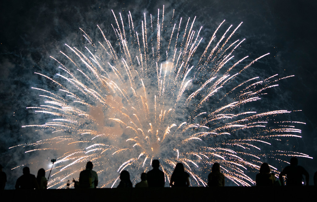 . Spectators watch a fireworks display on the east side of Manhattan, part of Independence Day festivities Wednesday, July 4, 2018, in New York. (AP Photo/Craig Ruttle)