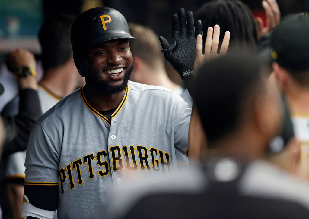 . Pittsburgh Pirates\' Gregory Polanco is congratulated by a teammate after Polanco hit a two-run home run in the second inning of a baseball game against the Cleveland Indians, Tuesday, July 24, 2018, in Cleveland. (AP Photo/Tony Dejak)