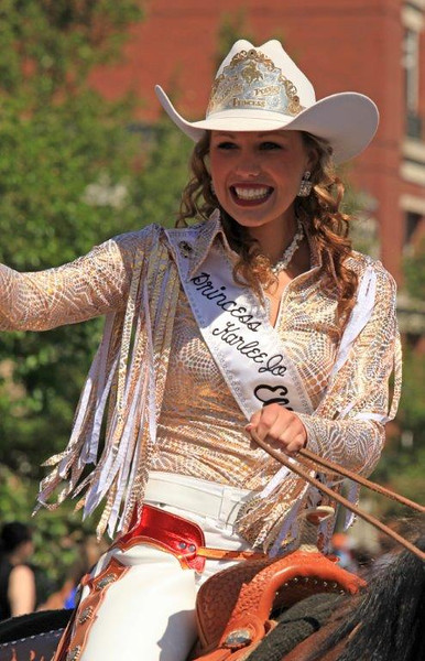 This year's rodeo princess takes a ride around the arena. WA