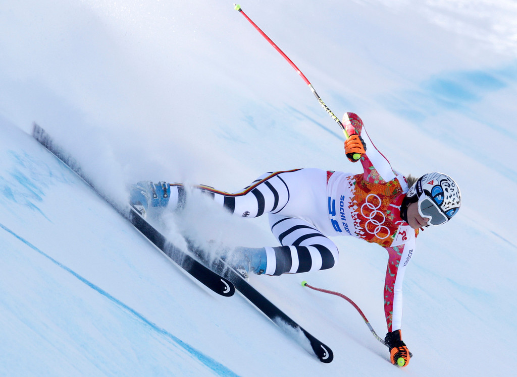 . Germany\'s Maria Hoefl-Riesch makes a turn during the women\'s downhill at the Sochi 2014 Winter Olympics, Wednesday, Feb. 12, 2014, in Krasnaya Polyana, Russia.(AP Photo/Charles Krupa)