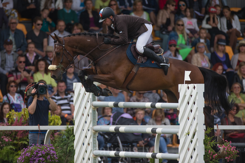 Alexandr BELEKHOV (RUS) with horse BIVALDI (90)  jumps over the obstacle, FEI World Cup Qualifying competition, CSI2*-W, Qualifier for OG RIO 2016, Riga, 02.08.2015
