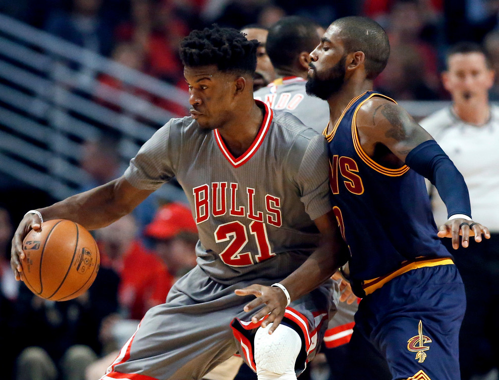 . Chicago Bulls guard guard Jimmy Butler, left, works against Cleveland Cavaliers guard Kyrie Irving during the first half of an NBA basketball game Friday, Dec. 2, 2016, in Chicago. (AP Photo/Nam Y. Huh)