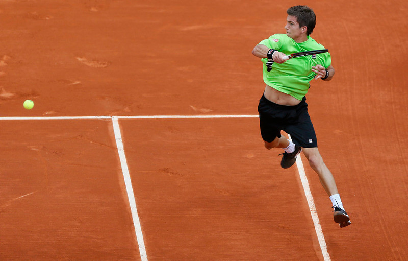 . Slovenia\'s Aljaz Bedene returns to France\'s Jo-Wilfried Tsonga during their  French Tennis Open first round match as part of the at the Roland Garros stadium in Paris, on May 27,  2013.   PATRICK KOVARIK/AFP/Getty Images