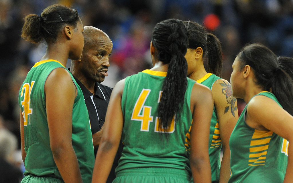 . Poly coach Carl Buggs talks with his players during a timeout at Sleep Train Arena in Sacramento, CA on Saturday, March 29, 2014. Long Beach Poly vs Salesian in the CIF Open Div girls basketball state final. 2nd half. Poly won 70-52. (Photo by Scott Varley, Daily Breeze)