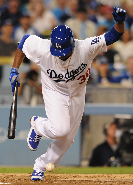 . Dodger pitcher Edinson Volquez avoids the ball after laying down a bunt that scored Juan Uribe in the 2nd inning. The Dodgers played the Arizona Diamondbacks at Dodger Stadium in Los Angeles, CA. 9/10/2013. photo by (John McCoy/Los Angeles Daily News)