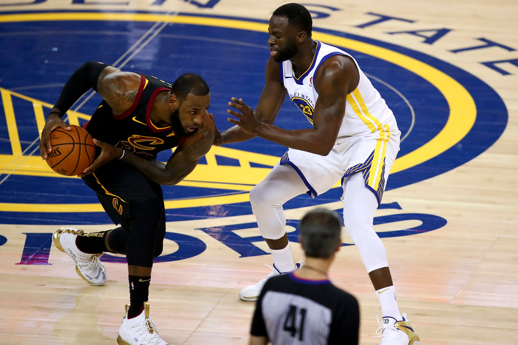 . Cleveland Cavaliers forward LeBron James, left, is defended by Golden State Warriors forward Draymond Green during the first half of Game 1 of basketball\'s NBA Finals in Oakland, Calif., Thursday, May 31, 2018. (AP Photo/Ben Margot)