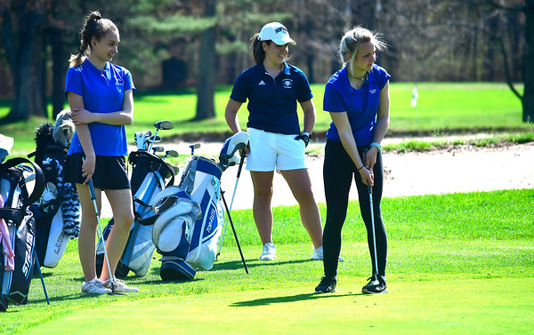4/23/2019 Mike Orazzi | Staff St. Paul's Jilian Kiazim and Lauralton Hall's Erin Eason look on as St. Paul's Sarah Richardson putts at the Westwoods Golf Course on Tuesday.