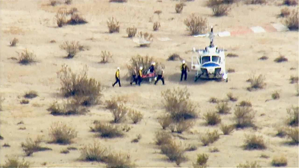 . In this image from video by KABC-TV Los Angeles, a rescue crew carries a person on a stretcher to a waiting helicopter near the scene of a crash of the SpaceShipTwo in Southern California\'s Mojave Desert on Friday, Oct. 31, 2014. A Virgin Galactic space tourism rocket exploded after taking off on a test flight, a witness said Friday. (AP Photo/KABC-TV)