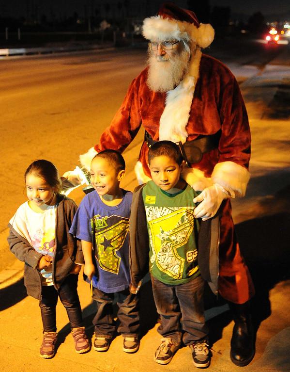 . The Community Ho Ho Parade up parade through the Street of San Bernardino Tuesday night December 17, 2013 in San Bernardino.LaFonzo Carter/ Staff Photographer