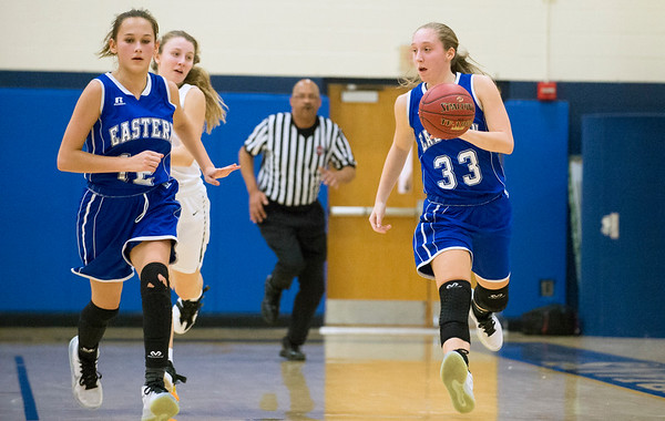 01/03/19 Wesley Bunnell | StaffrrNewington girls basketball vs Bristol Eastern at home Friday December 3, 2019. Jordan Oullette (33) brings the ball downcourt with Cali Doyon (12).