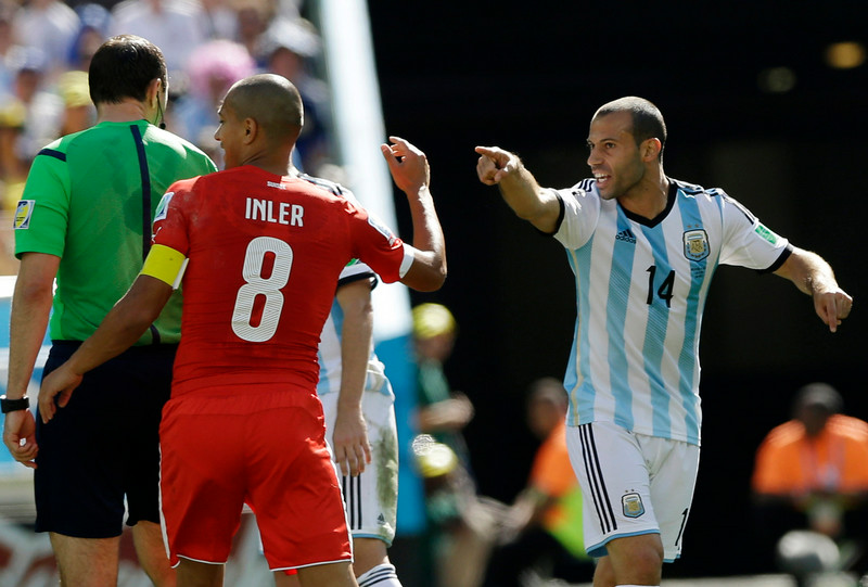 . Argentina\'s Javier Mascherano, right,  confronts Switzerland\'s Goekhan Inler during their World Cup round of 16 soccer match at the Itaquerao Stadium in Sao Paulo, Brazil, Tuesday, July 1, 2014. (AP Photo/Ricardo Mazalan)