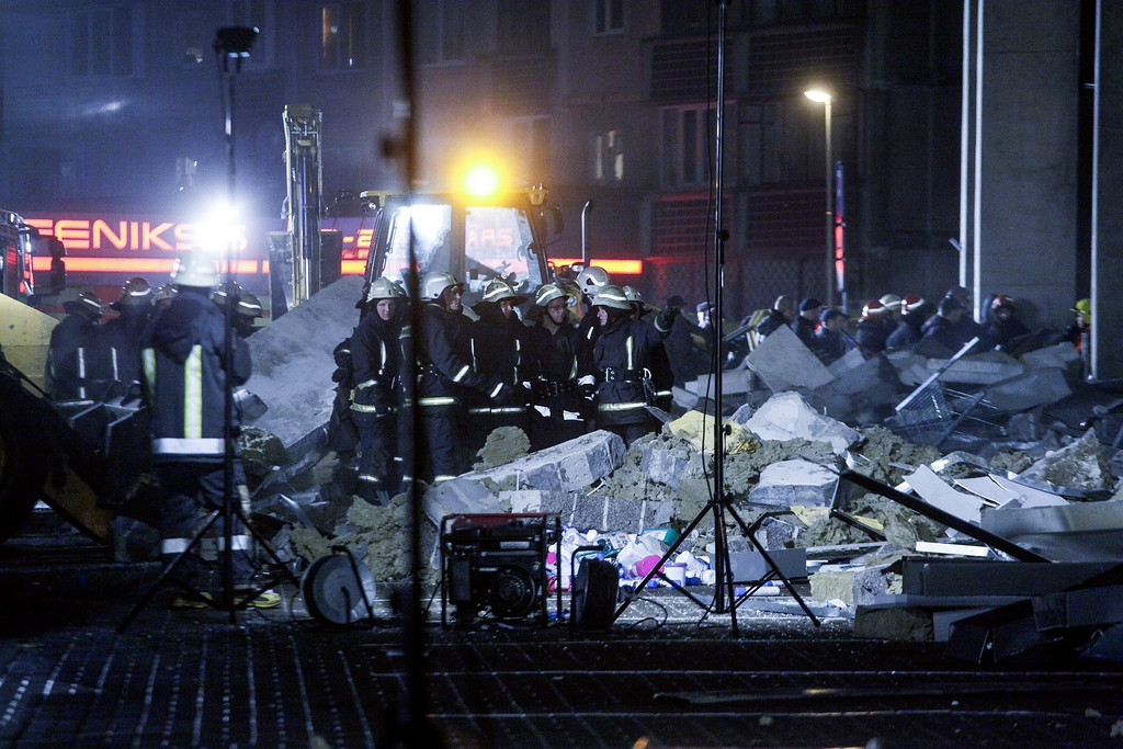 . Rescue workers outside the Maxima supermarket, after its roof collapsed in Riga, Latvia, 21 November 2013.   EPA/EMILS DESJATNIKOVS
