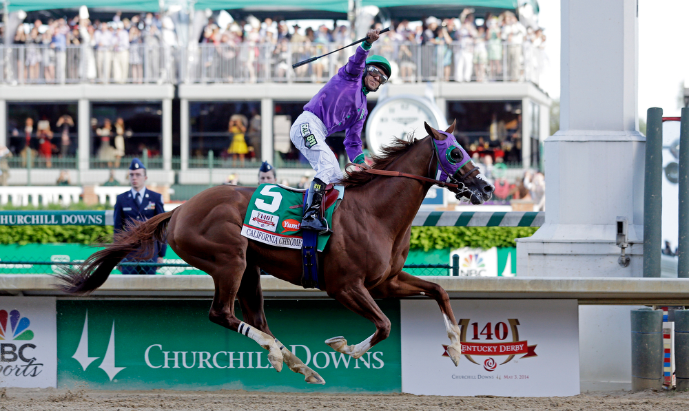 . Victor Espinoza rides California Chrome to a victory during the 140th running of the Kentucky Derby horse race at Churchill Downs Saturday, May 3, 2014, in Louisville, Ky. (AP Photo/Morry Gash)