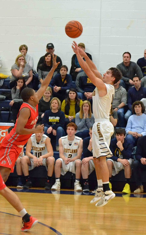 . Paul DiCicco - The News-Herald Kirtland�s Jeremy Davis shoots a 3-pointer late in the third quarter.