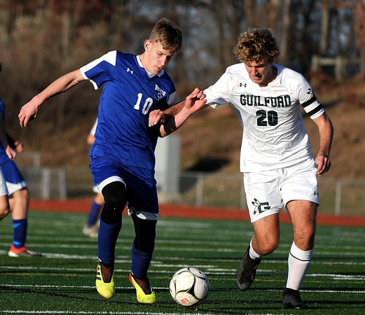 11/15/2019 Mike Orazzi | Staff Bristol Eastern's Jacob Woznicki (10) and Guilford's Aidan Buchanan (20) during the Class L Quarterfinal State Boys Soccer Tournament at Eastern on Friday.