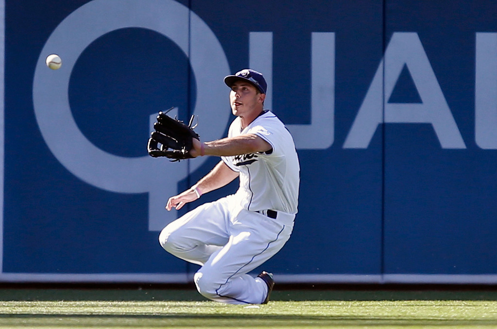 . San Diego Padres left fielder Tommy Medica makes a sliding catch on a line drive hit by Colorado Rockies\' Nolan Arenado to end the third inning with two runners in scoring position in a baseball game Wednesday, Aug. 13, 2014, in San Diego. (AP Photo/Lenny Ignelzi)