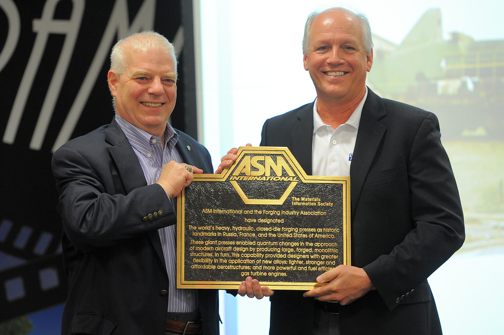 . Officials at Weber Metals had their 38,000-ton hydraulic forging press declared a historical landmark in Paramount, CA on Wednesday, April 16, 2014. Alton Romig, Jr., left, presents the plaque to Weber Metals President and CEO Rick Creed. ASM International gave the company the honor for their press, which when in stalled in 1982 was the largest of its kind west of the Mississippi. The company also held a ground breaking ceremony for their planned 60,000-ton press. (Photo by Scott Varley, Daily Breeze)