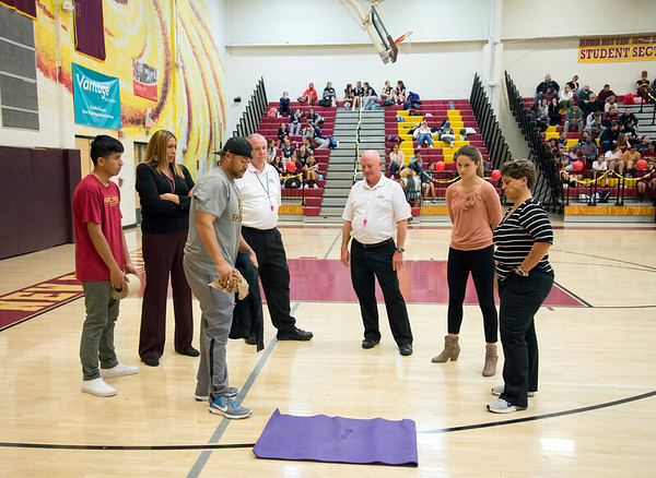 10/30/19 Wesley Bunnell | StaffrrCoaches and volleyball officials stand around as a pad absorbs rain water dripping onto the New Britain High School gym floor. The leak caused the postponement of the girls volleyball game vs Rocky Hill during the second set with the game to be continued tomorrow at Rocky Hill High School at 4p.m. as more rain is in the forecast.
