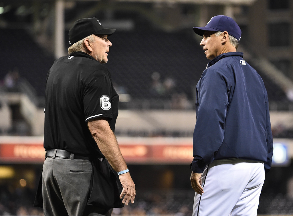 . SAN DIEGO, CA - SEPTEMBER 22:  Manager Bud Black #20 of the San Diego Padres argues a call with umpire Bob Davidson during the second inning of a baseball game against the Colorado Rockies at Petco Park September, 22, 2014 in San Diego, California.  (Photo by Denis Poroy/Getty Images)