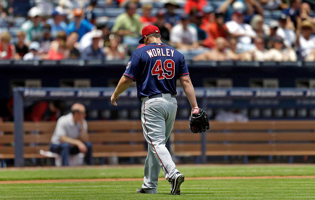 . Twins starting pitcher Vance Worley takes the long walk off the mound after giving up five runs to  the Braves in the fourth inning. Worley\'s line: eight earned runs on 10 hits, including three homers, over 3-2/3 innings.  (AP Photo/David Goldman)