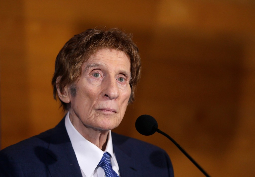 . FILE- In a file photo from Nov. 14, 2014, Detroit Tigers owner Mike Ilitch listens during a news conference in Detroit. Ilitch, the owner of the Detroit Red Wings and Tigers, who founded the Little Caesars Pizza empire, has died. He was 87. Family spokesman Doug Kuiper says Ilitch died Friday, Feb. 10, 2017, at a hospital in Detroit. Ilitch and his wife opened their first Little Caesars restaurant in suburban Detroit in 1959, and the business eventually grew into the world\'s largest carry-out pizza chain. (AP Photo/Carlos Osorio, File)