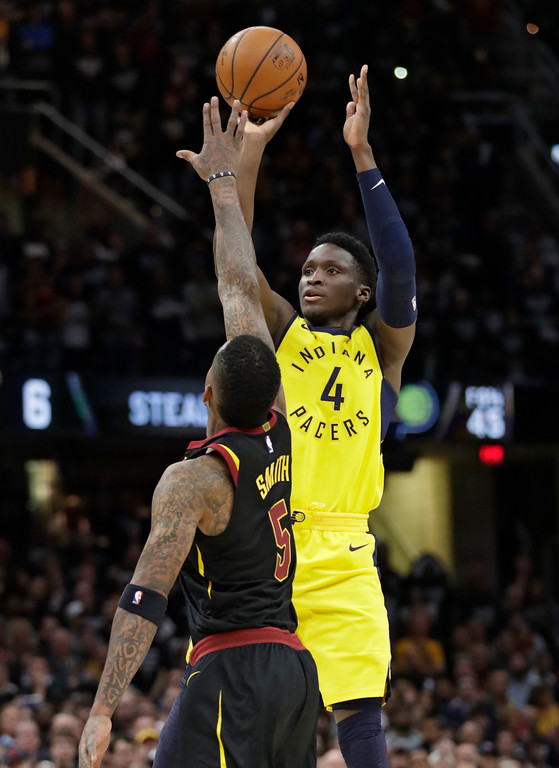 . Indiana Pacers\' Victor Oladipo (4) shoots over Cleveland Cavaliers\' JR Smith (5) in the second half of Game 7 of an NBA basketball first-round playoff series, Sunday, April 29, 2018, in Cleveland. (AP Photo/Tony Dejak)