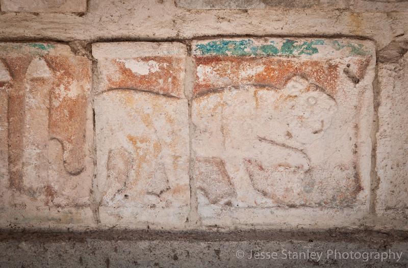 Jaguar carvings arcoss from the Templo de las Mesas, Chichen Itza