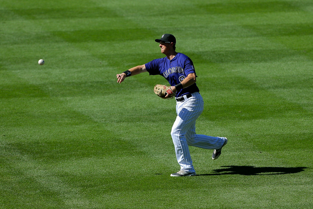 . DENVER, CO - SEPTEMBER 3:  Second baseman DJ LeMahieu #9 of the Colorado Rockies throws to first base for the second out of the seventh inning against the San Francisco Giants at Coors Field on September 3, 2014 in Denver, Colorado. (Photo by Justin Edmonds/Getty Images)