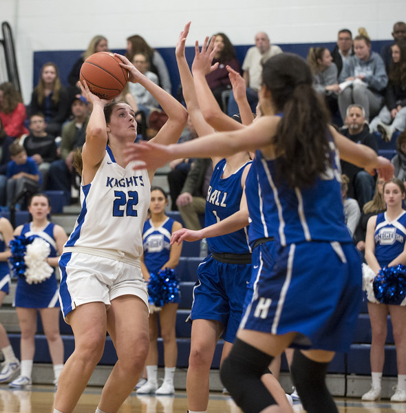 01/28/20   Wesley Bunnell   Staff  Southington girls basketball defeated Hall in a home contest on Tuesday night. Kelley Marshall (22).