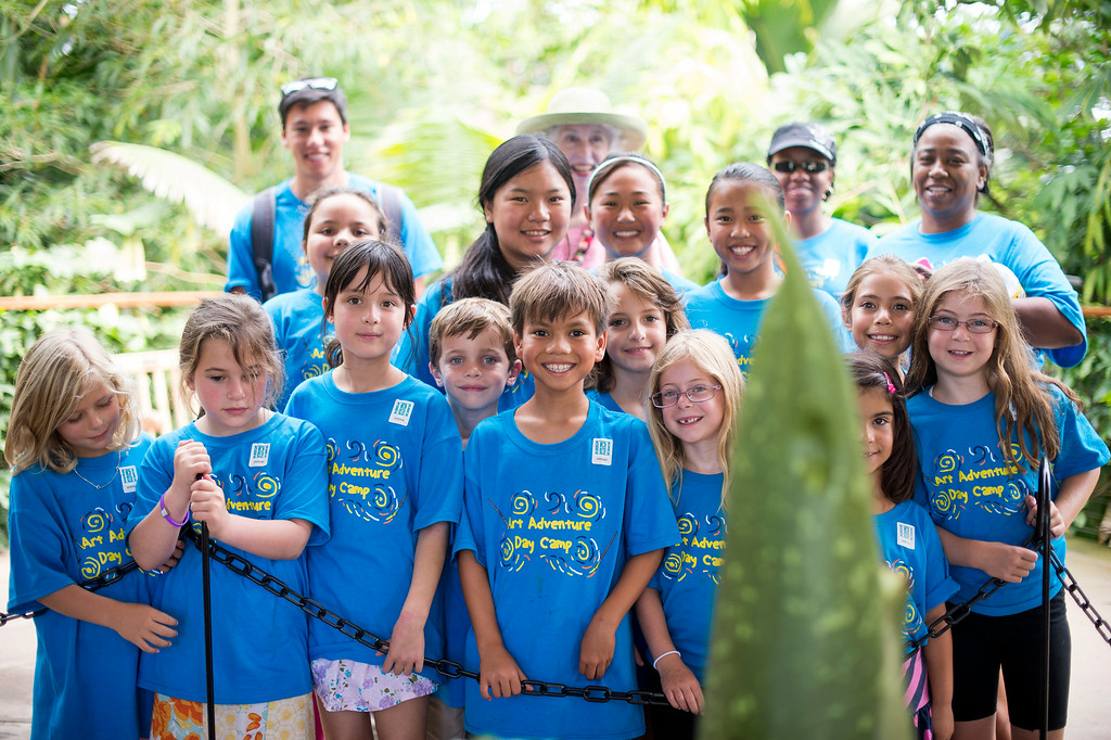 . The Manhattan Beach Art Adventure Day Camp poses with The Huntington�s Corpse Flower Thursday, August 14, 2014 at The Huntington in San Marino. The flower, which smells like rotting flesh, is expected to bloom within a week. In 1999 some 76,000 people showed up for the 1999 bloom of the �Stinky Flower.� That event was the first-ever in California and created an international sensation.(Photo by Sarah Reingewirtz/Pasadena Star-News)