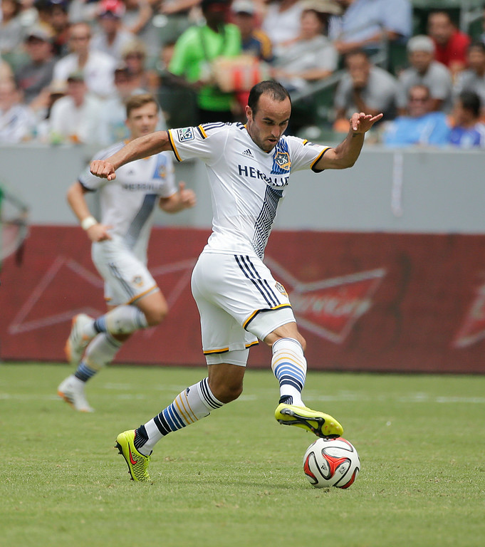. In this Saturday, Aug. 2, 2014 photo, Los Angeles Galaxy\'s Landon Donovan controls the ball during the second half of an MLS soccer match against Portland Timers in Carson, Calif. Donovan says he will retire from professional soccer at the end of the MLS season. (AP Photo/Jae C. Hong)