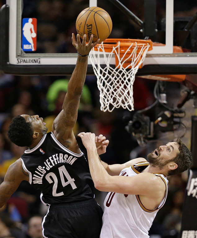 . Brooklyn Nets\' Rondae Hollis-Jefferson (24) drives against Cleveland Cavaliers\' Kevin Love (0) in the first half of an NBA basketball game, Friday, Jan. 27, 2017, in Cleveland. (AP Photo/Tony Dejak)