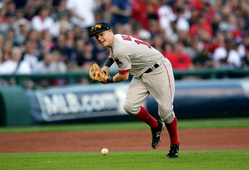 . Boston Red Sox third baseman Brock Holt cannot handle a Cleveland Indians\' Jose Ramirez ground ball in the second inning during Game 2 of baseball\'s American League Division Series, Friday, Oct. 7, 2016, in Cleveland. (AP Photo/Aaron Josefczyk)