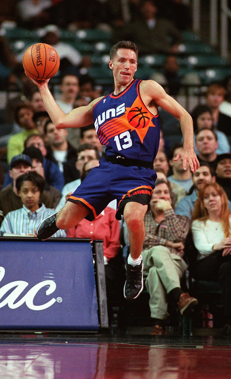 . Phoenix Suns guard Steve Nash gets airborne to save the ball from going out of bounds against the Atlanta Hawks in the first half on Monday, Jan. 26, 1998, at the Georgia Dome in Atlanta. The Suns defeated the Hawks 96-91. (AP Photo/Erik S. Lesser)