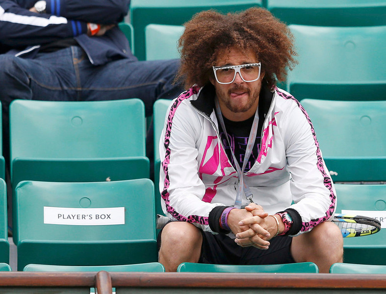 . Redfoo, also known as Stefan Gordy of the band LMFAO, watches as his girlfriend Victoria Azarenka of Belarus plays Francesca Schiavone of Italy in their women\'s singles match during the French Open tennis tournament at the Roland Garros stadium in Paris June 3, 2013. REUTERS/Vincent Kessler