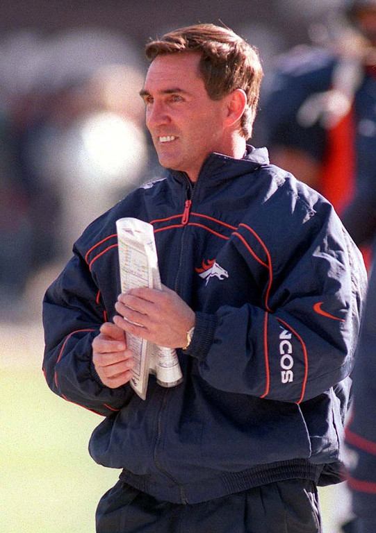 . Denver blew out Miami, out gaining them in rushing yards 250-14 and scoring touchdowns on their first three possessions. Denver won the AFC Divisional Playoff game 38-3.   Broncos head coach Mike Shanahan walks the sideline during an AFC Divisional Playoff game against the Miami Dolphins in Denver Jan. 9, 1999. The Broncos meet the Atlanta Falcons in Super Bowl XXXIII Jan. 31, 1999 in Miami. (AP Photo/Eric Gay)
