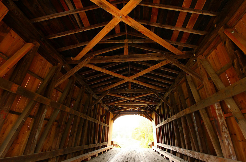 A variety of truss designs were used on the covered bridges. All the designs have names, such as this multiple kingpost. This is  the Kingsbury Bridge in South Randolph, Vermont.