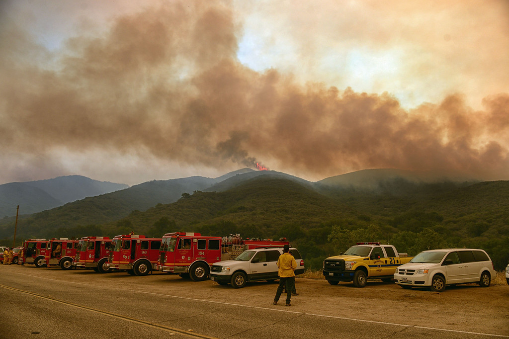 . A LACO Fire trucks stand by as the Springs Fire moves closer along W Potrero Rd in Thousand Oaks Friday, May 3, 2013. (Hans Gutknecht/LA Daily News)