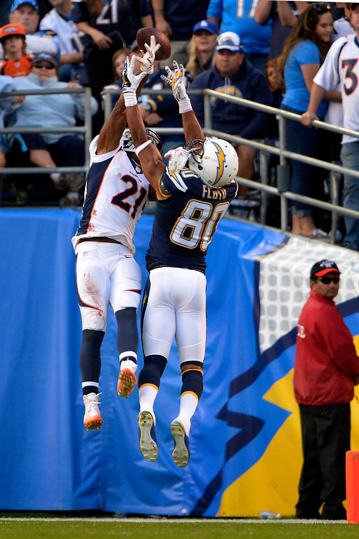 . SAN DIEGO, CA. December 14, - cornerback Aqib Talib #21 of the Denver Broncos breaks up a strike in the end zone to wide receiver Malcom Floyd #80 of the San Diego Chargers at Qualcomm Stadium December 14, 2014 San Diego, CA (Photo By Joe Amon/The Denver Post)
