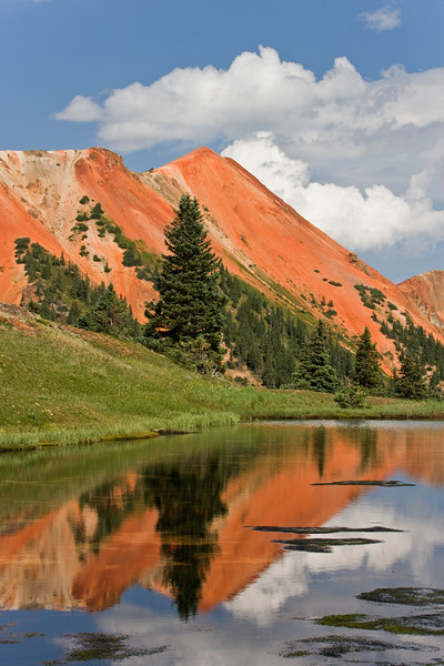 Reflection of red peaks in lake at Hurricane Pass near Silverton, Colorado