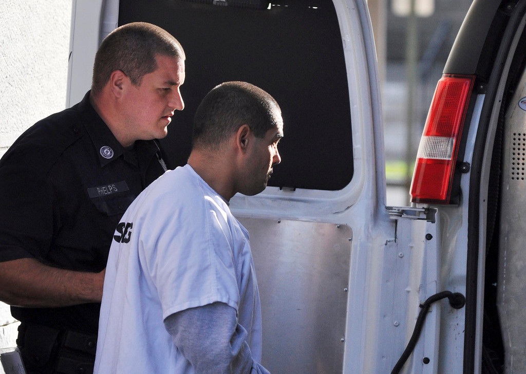 . David T Chalue exits Berkshire Superior Court  under increased security after being arraigned on multiple charges, including murder, Wed Oct 12, 2011 (GARVER)