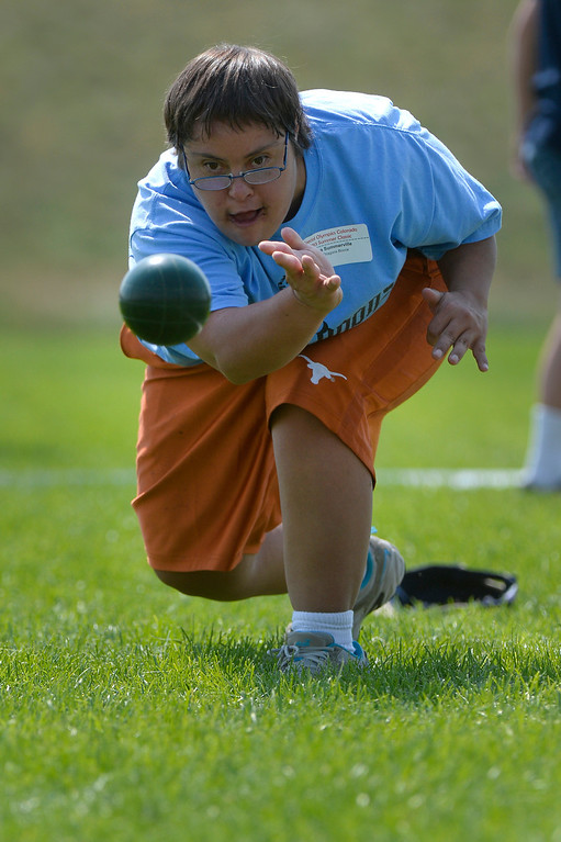 . DENVER, CO. - AUGUST 17: Laura Summerville plays bocce against Jennifer Regan in the Special Olympics state championship at the Lowry Sports Complex in Denver, CO August 17, 2013. Special Olympics Colorado hosted its state championship in Bocce, Cycling, Golf, Softball and Tennis. Six hundred athletes competed in the events, which was supported by 250 volunteers and coaches. (Photo By Craig F. Walker / The Denver Post)