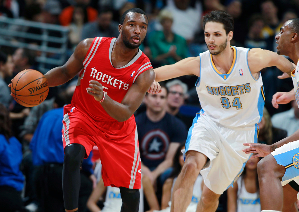 . Houston Rockets forward Jordan Hamilton, left, works the ball inside as Denver Nuggets guard Evan Fournier, center, of France, and forward Quincy Miller defend during the third quarter of the Nuggets\' 123-116 victory in an NBA basketball game in Denver on Wednesday, April 9, 2014. (AP Photo/David Zalubowski)